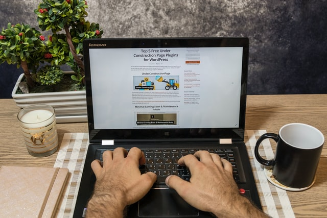 A man reading an article on his laptop